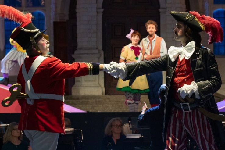 Richard Burkhard as Major-General Stanely, John Savournin as The Pirate King, Daisy Brown as Mabel and Peter Kirk as Frederic in The Pirates of Penzance at Opera Holland Park, 2021 © Ali Wright