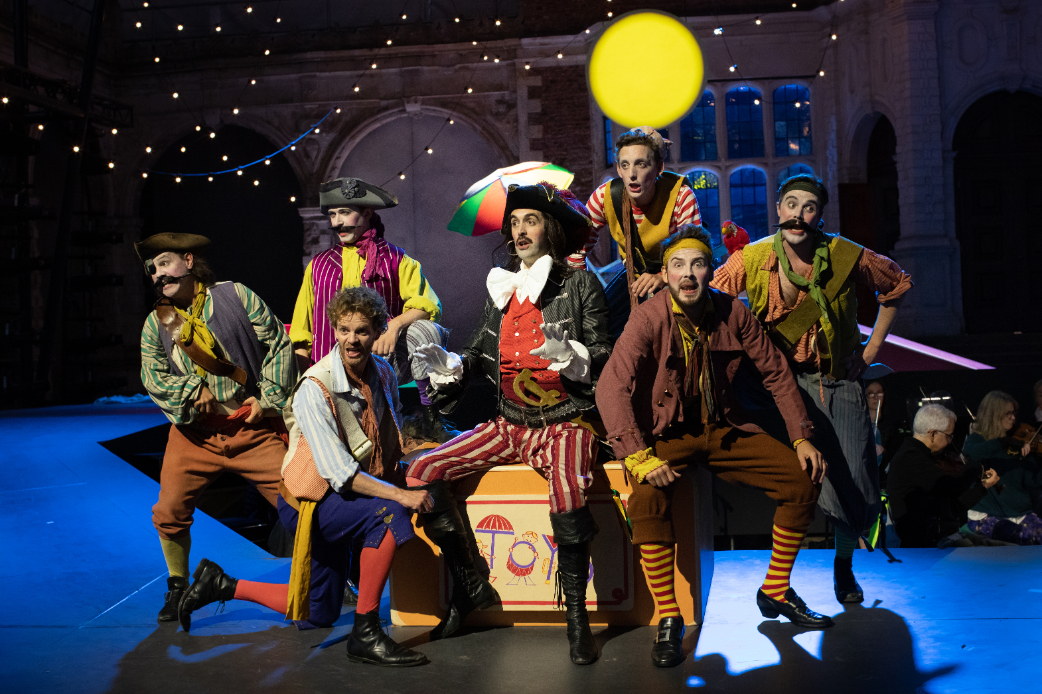 John Savournin as The Pirate King, Frederick Long as Samuel and Peter Kirk as Frederic with members of the Opera Holland in The Pirates of Penzance at Opera Holland Park, 2021 © Ali Wright